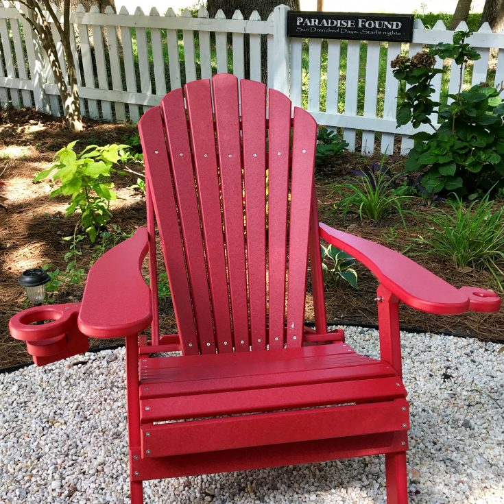 Outer Banks Collection Deluxe Adirondack Chair in Backyard