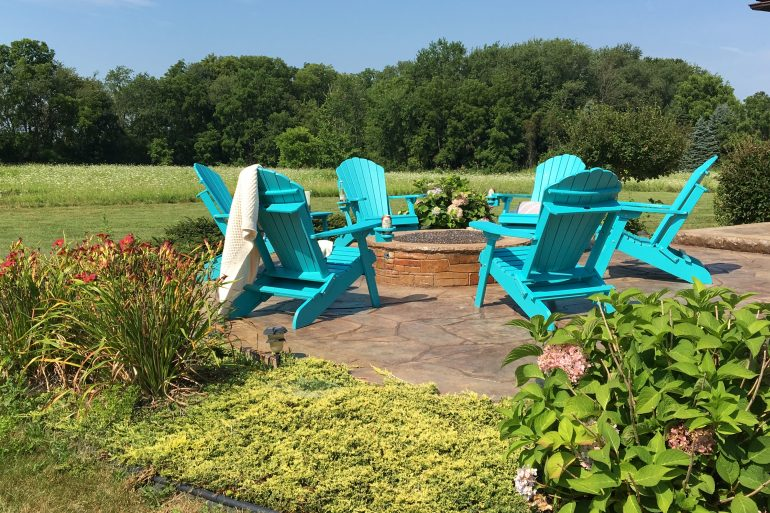 Aruba Blue Deluxe Adirondack Chairs on a Patio