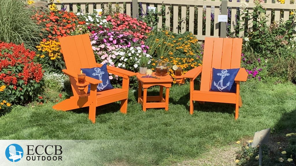 ECCB Outdoor Bright Orange Creek Side Adirondack Chairs in Garden with Harbor Side Table
