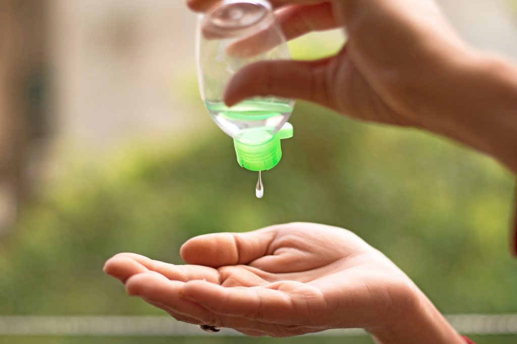 human hands using sanitizer to clean himself