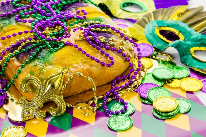 Freshly baked cheese King Cake for celebrating Mardi Gras.